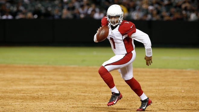 Arizona Cardinals quarterback Phillip Sims (1) rolls out against the Oakland Raiders during the second half of an NFL preseason football game in Oakland, Calif., Sunday, Aug. 30, 2015.