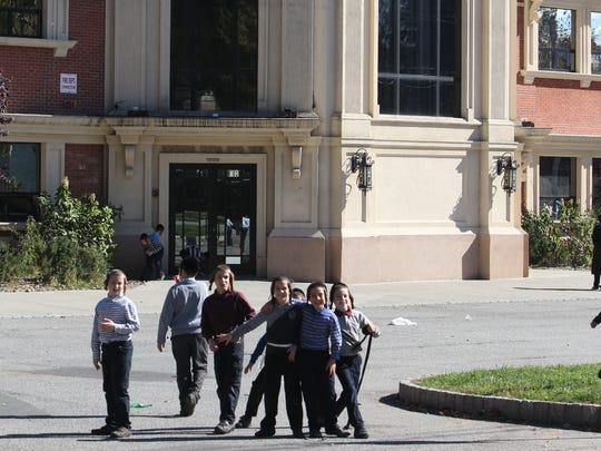 Children outside of United Talmudical Academy in Spring