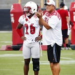 Defensive coordinator Todd Grantham and cornerback Duke Culver look on during practice.