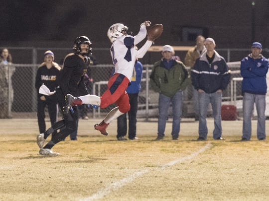 Tulare Western's Payton Silva intercepts a pass intended