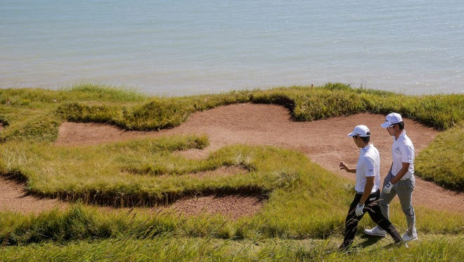 Can't get out of that sand trap? A proposed rule would allow players to remove their ball from the bunker for a two-stroke penalty.