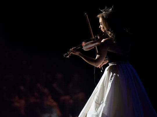 Miss Tennessee's 2017 Outstanding Teen Autumn Arsenault performs on her violin Saturday, March 10, 2018, during the Miss Tennessee Outstanding Teen pageant at the Carl Perkins Civic Center in Jackson.