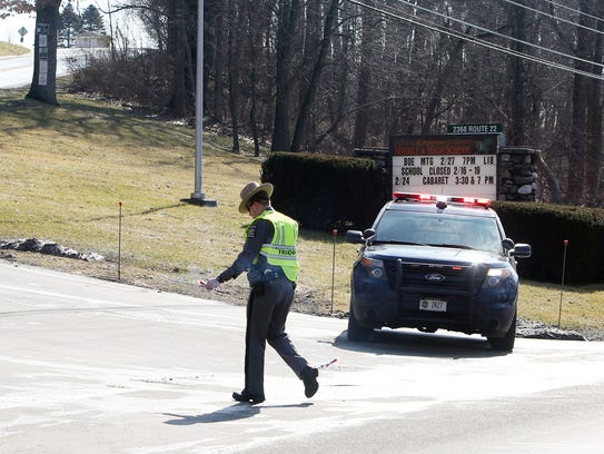 A state trooper blocks the entrance to Dover High School