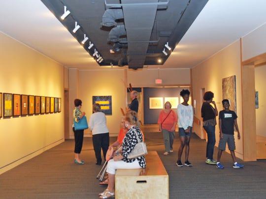 Guests enjoy an exhibit at the Foosaner Art Museum.
