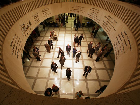 Lobbyists, lawmakers, journalists, and guests fill the fourth floor Rotunda of the Florida Capitol, Friday, May 2, 2104, the last day of the annual 60 day session in Tallahassee.