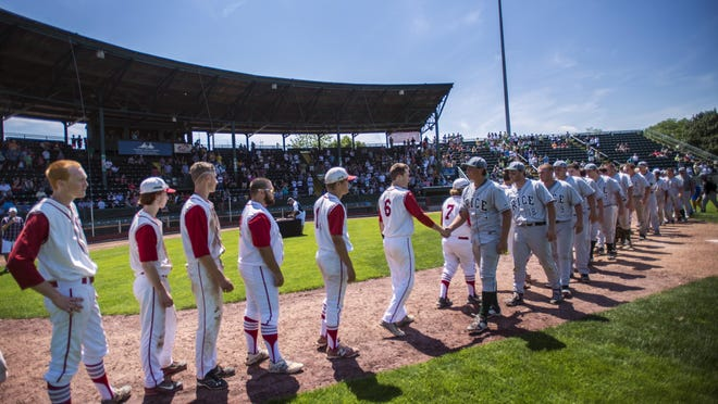 Rice and CVU players shake hands at the end of the Division I state high school baseball championship at Centennial Field in Burlington on Saturday, June 13, 2015.