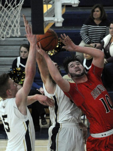 Fairfield Union's Lucas Thompson fights for the rebound