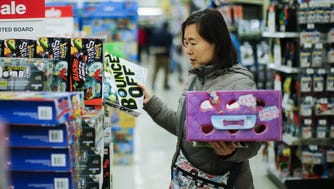 "A shopper looks for gifts inside of the Toys""R""Us store during early Black Friday events on Nov. 24, 2016 in Paramus, NJ."