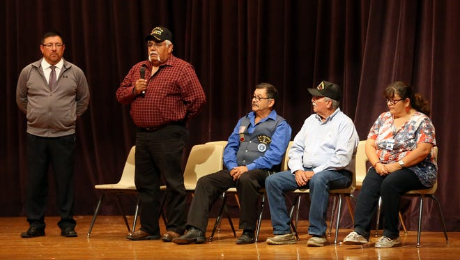 Veteran Israel Ramirez talks to high school seniors about his time serving in the military with other veterans Friday, Nov. 11, 2016, at Premont High School in Premont.