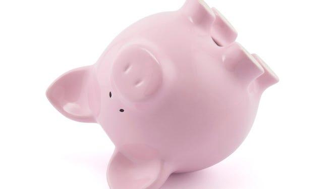 Pink piggy bank upside down.  Credit: Jakub Krechowicz, Getty Images GETTY ID#: 134061432
