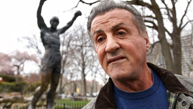 "Sylvester Stallone talks to reports in front of the Rocky statue for a ""Creed II"" photo op, Friday, April 6, 2018, in Philadelphia. The film, part of the ""Rocky"" film franchise, will be released later this year."