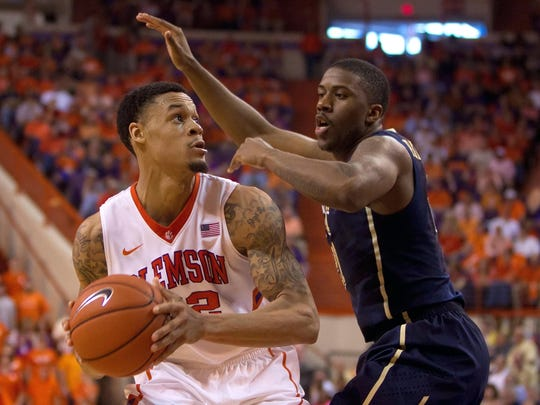 Clemson Tigers forward K.J. McDaniels (32) drives to the basket while being defended by Pittsburgh forward Lamar Patterson on March 8, 2014.