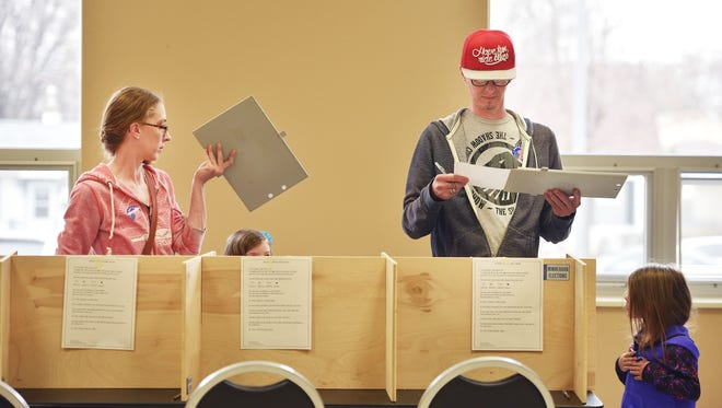 Cari and Lance Jeschke vote with their daughters Sparrow and Willow Tuesday, May 1, for the Mayoral Elections at Oyate Community Center in Sioux Falls.