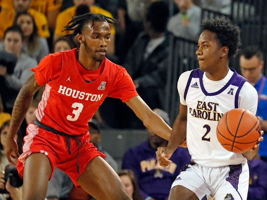 East Carolina's Tristen Newton (2) works the ball against Houston's DeJon Jarreau (3) during the first half of an NCAA college basketball game in Greenville, N.C., Wednesday, Jan. 29, 2020. (AP Photo/Karl B DeBlaker)