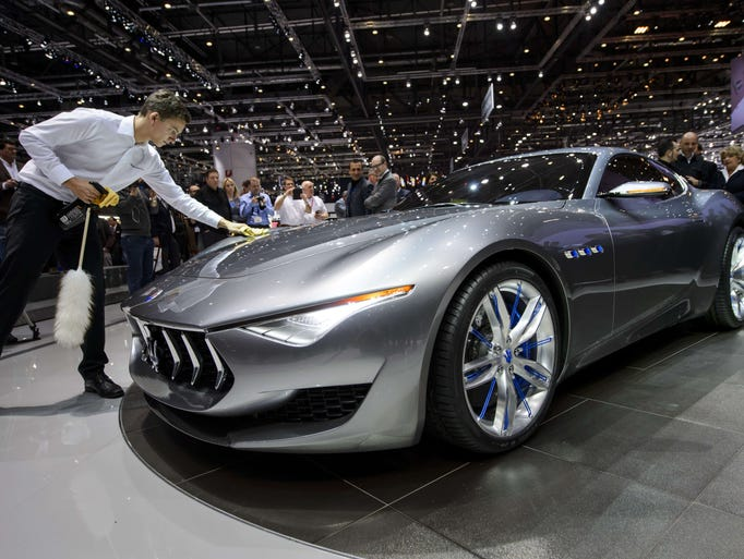 The new Maserati Alfieri concept car gets a touch upat the Italian carmaker's booth during the press day of the Geneva Motor Show