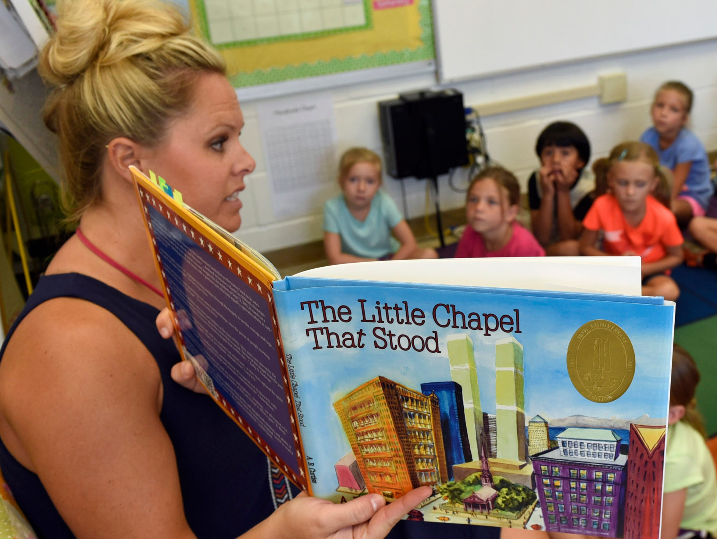 Brooke Gable reads to her first-grade class on Thursday,