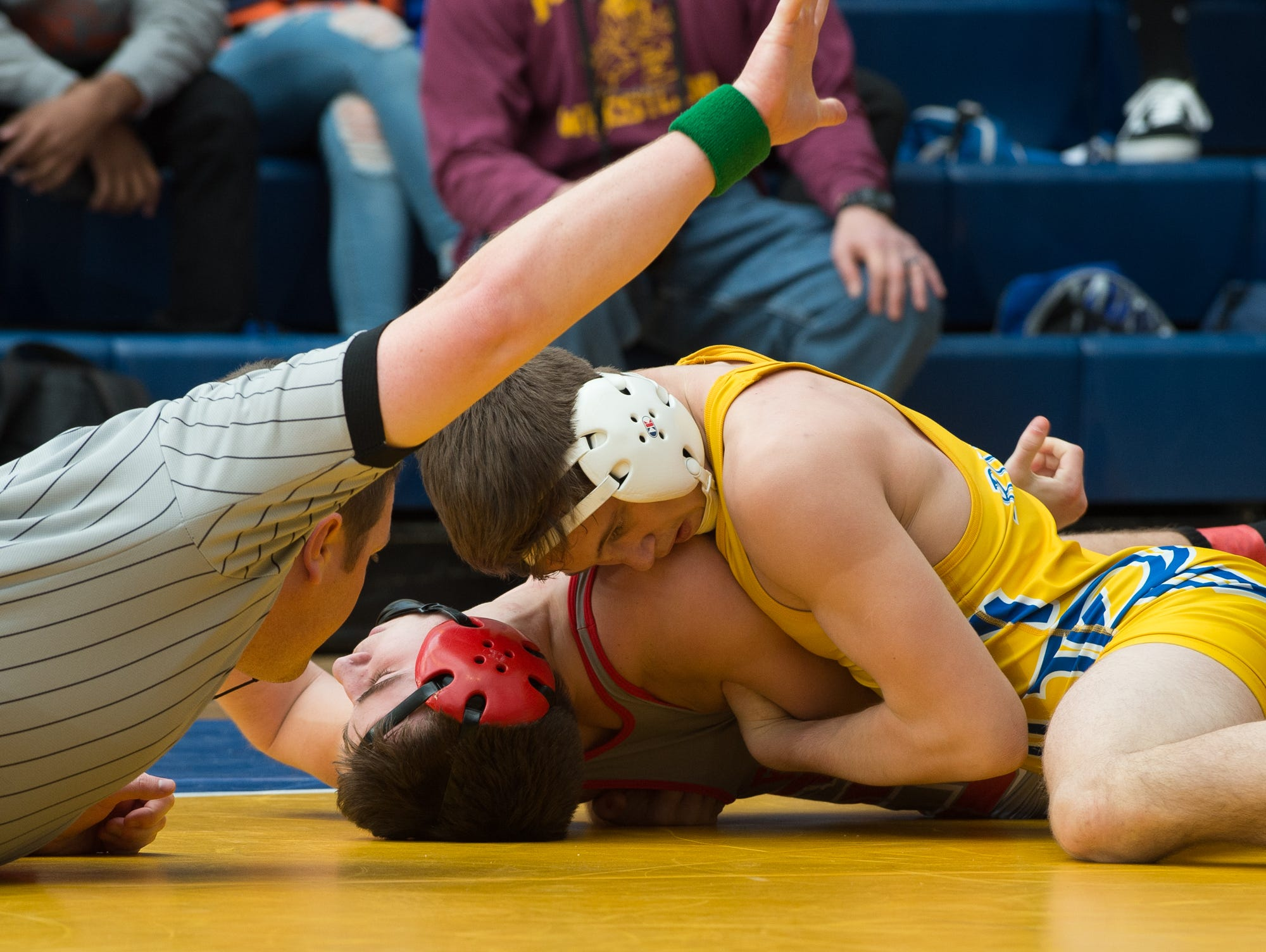 Caesar Rodney's Jackson Dean tries for a pin on Smyrna's Greg Baum in the 132 pound championship match at the Henlopen Conference wrestling tournament at Sussex Central High School.