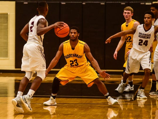 Northmor's Meechie Johnson guards the ball during a tournament game last season.