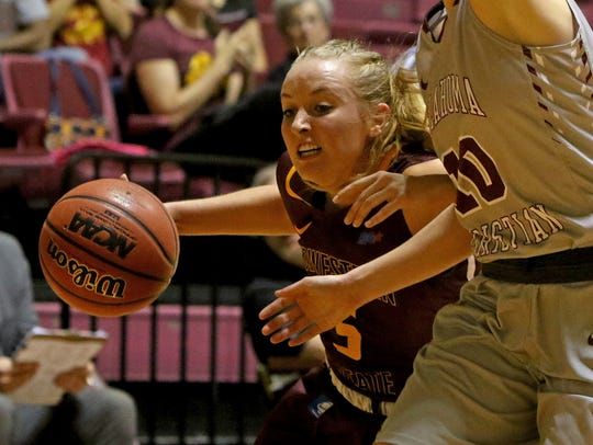 Midwestern State's Kristen Rydell drives to the basket