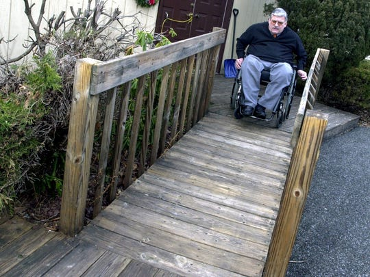 -  -Terry Moakley, Associate Executive Director for the Eastern Paralyzed Veterans Association, guides his wheelchair up a ramp to enter his West Nyack home Jan. 11, 2004. The ramp was designed and built by the facilities management staff of the organization, which is the kind of service that the Eastern Paralyzed Veterans Association provides. WITH CACIOPPO STORY ( Kathy Gardner / The Journal News )ad