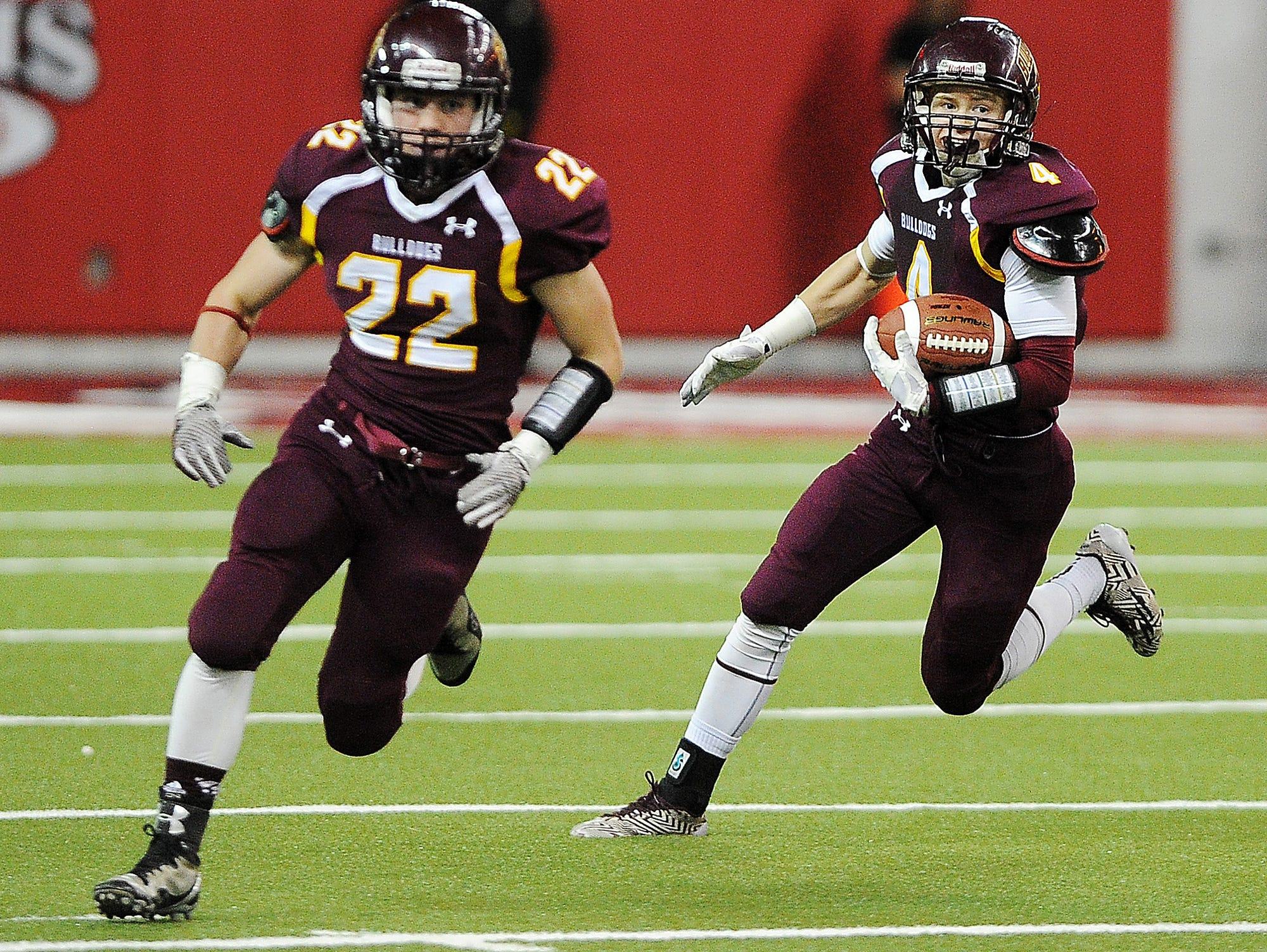 Madison's Mason Leighton (4) carries the ball during the first half of the 2014 South Dakota state Class 11A Championship game against Dell Rapids on Thursday, Nov. 13, 2014, at the DakotaDome in Vermillion, S.D.