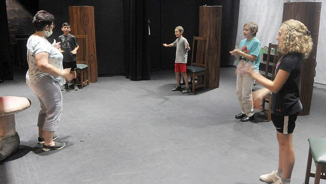 Instructor Traci Cooper (left to right) works with Leo Vasquez, Zach Manchester, Elijah Adams and Amber Manchester in the drama portion of the Arts Alive Create a Story summer camp June 9 at the Ohio Theater. Breaking the Arts Alive camps into smaller groups has opened them to more students.