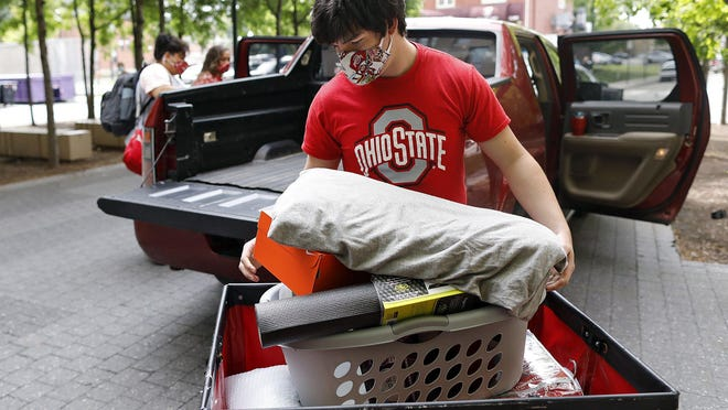 Freshmen Mason Bell, of Dover, moves into his dorm at Smith-Steeb Hall on campus of Ohio State University Wednesday.