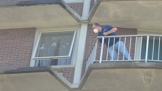 A Brockton police detective investigates after a boy fell from a ninth-floor window of Belair Towers in Brockton on Sunday, June 21, 2020.