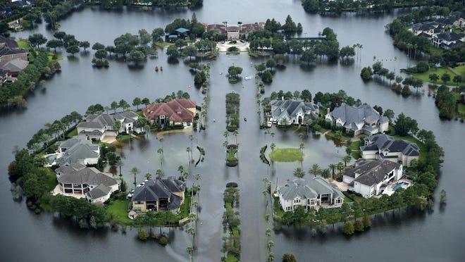 Flood waters rise Lakes on Eldridge North neighborhood near the Addicks Reservoir in Houston, Texas, on August 30, 2017.