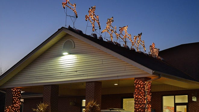 If you are going to install lights and displays on your roof, make sure you have help and the proper equipment.
