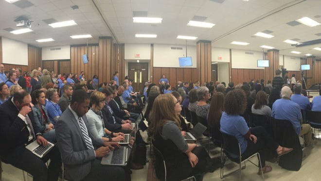 A crowded Indianapolis Public Schools meeting room awaits a hearing on an immigration resolution Thursday, Feb. 23, 2017.