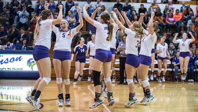 Bronson players celebrate after beating Bridgman in first round of regionals on Nov. 10.