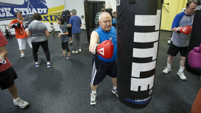 """Jack Shulse """"Snoopy,"""" Indianapolis, works on a heavy bag at Rock Steady Boxing, Indianapolis, July 10, 2015. The gym is dedicated to working as a form of physical therapy for Parkinson's patients."""