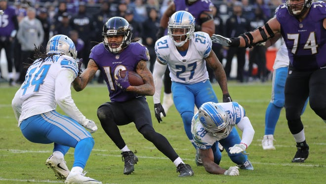 Lions defenders tackle the Ravens' Chris Moore during the fourth quarter of the Lions' 44-20 loss on Sunday, Dec. 3, 2017, in Baltimore.