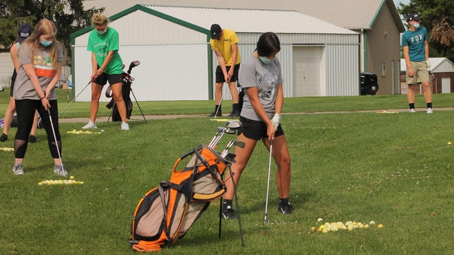 In this file photo from last year, members of the Annawan-Wethersfield golf team practice chipping at the Kewanee Dunes golf course, renamed Midland Golf Course this year.