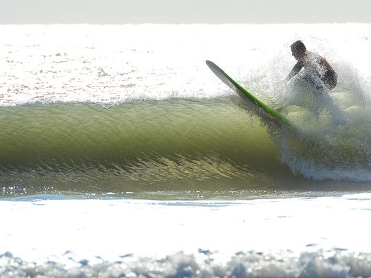 A surfer competes in the Maryland State Surfing Championships in 2017 at 36th Street in Ocean City.