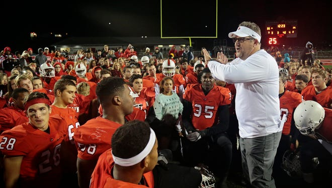 Colerain head coach Tom Bolden debriefs his team after the OHSAA Div. I Region 4 playoff game between the Colerain Cardinals and the Springboro Panthers at Colerain High School in Colerain Township, Ohio, on Friday, Nov. 4, 2016. Colerain advanced in the playoffs with a 35-14 win over Springboro.