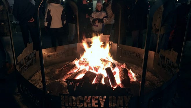 Nikista Zaun, 9, watches a bonfire at Lake George Sunday night. The Winter Village, set up for Hockey Day Minnesota, became home to Vikings fans as they watched NFC Championship game.