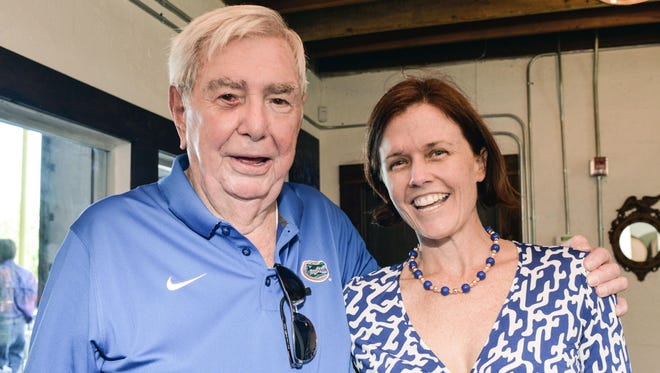 Treasure Coast Gator Club founding member and scholarship donor Fritz Addison chats with President-Elect Amy Speak at the recent gathering at Walking Tree Brewery, Vero Beach.
