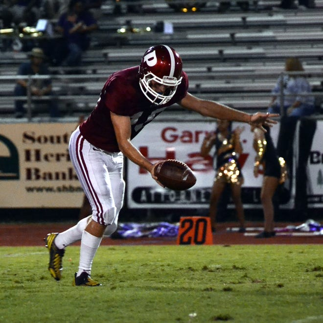 Pineville senior Landon Weeks punts against Marksville two weeks ago. Weeks pinned the Tigers inside the 20-yard line three times, just two weeks after twice backing Tioga up at its 1-yard line late in a Rebels' victory.