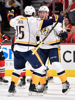 Nashville Predators center Colton Sissons (10) celebrates his goal with right wing Craig Smith (15) in the second period of game two in the first-round NHL playoff series at the United Center, Saturday, April 15, 2017, in Chicago, Ill.