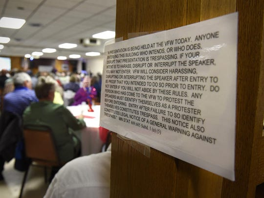 A sign outlines policies for people attending Ron Branstner's