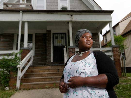 Jameelah Love stands in front of her childhood home on North 23rd Street just south of West Center Street in Milwaukee, where she lived when she was 17 years old. Love is a case of transgenerational trauma. Her parents were abused, and her Dad has been in and out of jail in her entire lifetime. Jameelah suffered from abuse and neglect as a child and grew up in foster care, taken from her home and separated from her siblings.