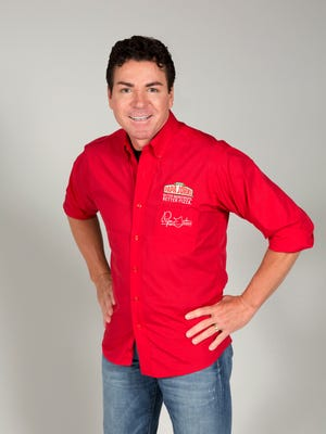 John Schnatter, the founer, CEO and chief spokesman for Papa John's pizza empire, poses during a the filiming of commercial for the business.