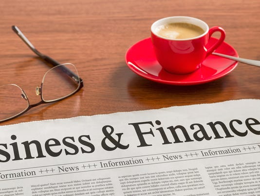A newspaper on a wooden desk - Business and Finance