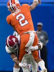 Alabama defensive back Deionte Thompson (14) wraps up Clemson quarterback Kelly Bryant (2) as Bryant throws a pass in first half action in the Sugar Bowl at the Superdome in New Orleans, La. on Monday January 1, 2018. (Mickey Welsh / Montgomery Advertiser)