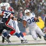 Indianapolis Colts' Mike Hart runs during the second half of the NFL football game against the Buffalo Bills in Orchard Park, N.Y., Sunday, January 3, 2010. Hart returns to his native Syracuse to coach running backs at SU.