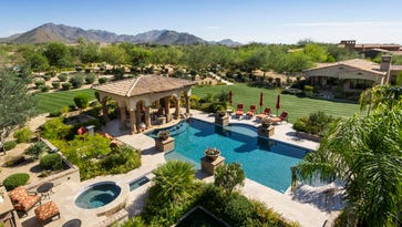 Luxury homes: $4.7M Scottsdale mansion has secret room, 2 towers and tennis court
