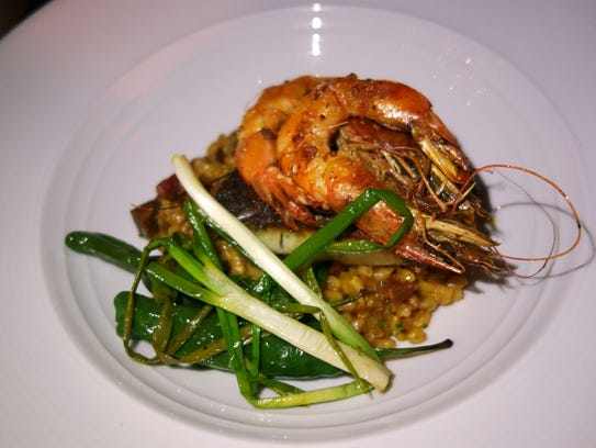 Sea bass and Kauai shrimp with saffron farro risotto, chorizo, charred i'itoi onions and shishito peppers at Lon's at the Hermosa.