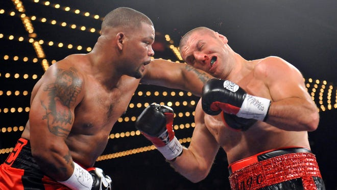 Mike Perez, left, lands a hard left hook on the head of Magomed Abdusalamov during their heavyweight bout Saturday. Abdusalamov underwent brain surgery after the fight to remove a blood clot from his brain.